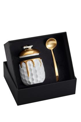 وعاء عسل بتصميم خلية نحل