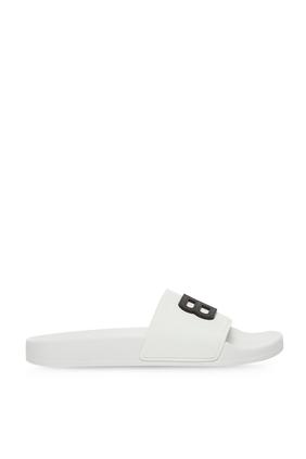 حذاء مفتوح من الخلف بشعار الماركة مطاط