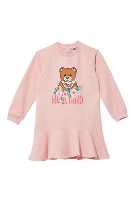 فستان بطبعة الدب تيدي وشعار الماركة وزهور