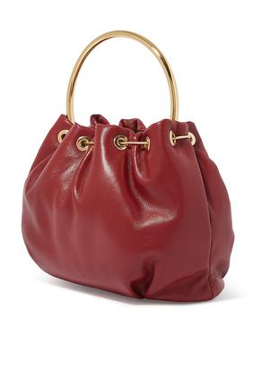 حقيبة باكيت بيد ذهبية